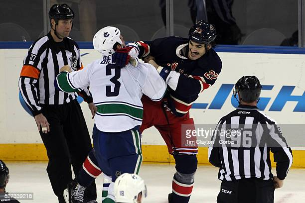 Kevin Bieksa Vancouver Canucks and Brian Boyle New York Rangers fighting at the end of the game during the New York Rangers Vs Vancouver Canucks NHL...