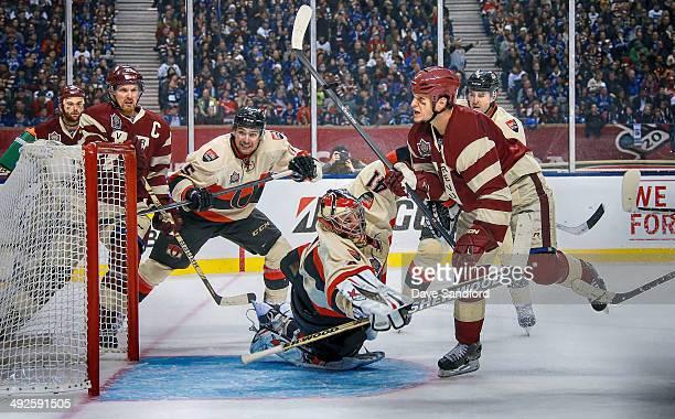 Kevin Bieska of the Vancuver Cannucks attacks the net against goalie Craig Anderson of the Ottawa Senators during the 2014 Tim Hortons NHL Heritage...