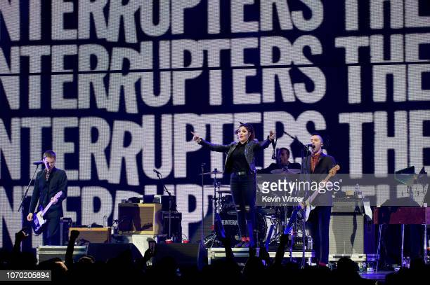 Kevin Bivona Aimee Allen Jesse Bivona and Justin Bivona of the band The Interrupters perform on stage during the KROQ Absolut Almost Acoustic...
