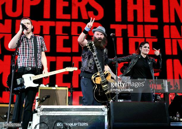 Kevin Bivona of the band The Interrupters Tim Armstrong of the band Rancid and Aimee Allen of the band The Interrupters perform on stage during the...