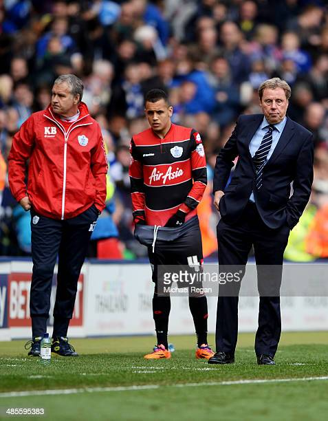 Kevin Bond assistant manager of Queens Park Rangers Ravel Morrison of Queens Park Rangers and Harry Redknapp manager of Queens Park Rangers look on...
