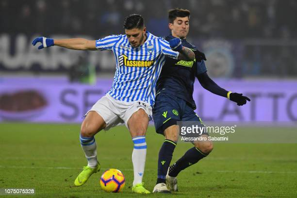 Kevin Bonifazi of Spal competes for the ball with Ignacio Pussetto of Udinese Calcio during the Serie A match between Spal and Udinese at Stadio...