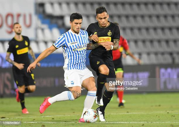 Kevin Bonifazi of SPAL competes for the ball with Lautaro Martinez of FC Internazionale during the Serie A match between SPAL and FC Internazionale...