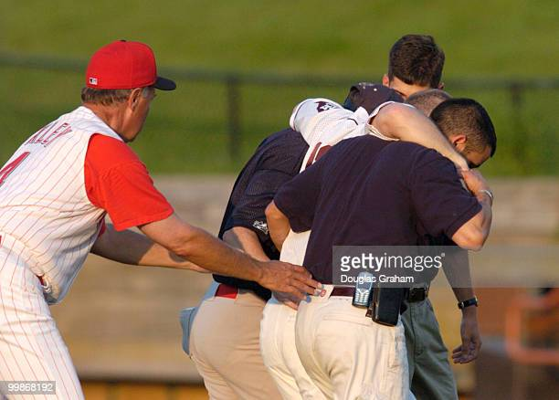 Kevin Brady is helped off the field after pulling his hamstring at 2nd base during the 2004 Congressional Baseball Game