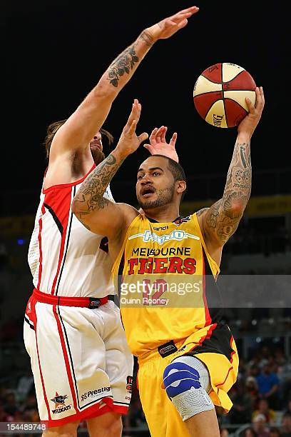 Kevin Braswell of the Tigers shoots during the round three NBL match between the Melbourne Tigers and the Perth Wildcats at Hisense Arena on October...