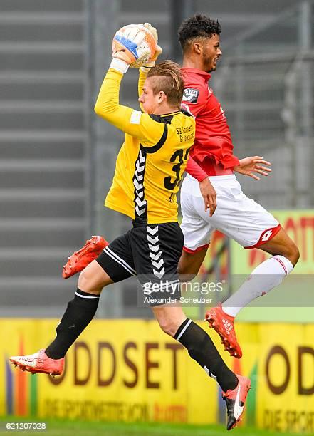 Kevin Broll of Grossaspach challenges Aaron Seydel of Mainz 05 during the Third League match between 1 FSV Mainz 05 II and SG Sonnenhof Grossaspach...