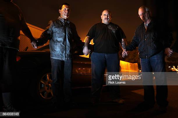 Kevin Brown left a retired police officer turned pastor leads a short prayer in a Santa Ana parking lot before the group sets out on a mission A...