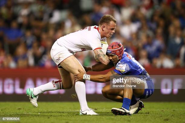 Kevin Brown of England fends off Pita Godinet of Samoa during the 2017 Pacific Test Invitational match between England and Samoa at Campbelltown...