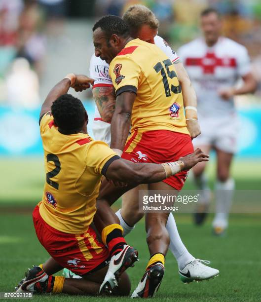 Kevin Brown of England is nearly knocked out by a big tackled from Stargroth Amean of Papua New Guinea during the 2017 Rugby League World Cup Quarter...