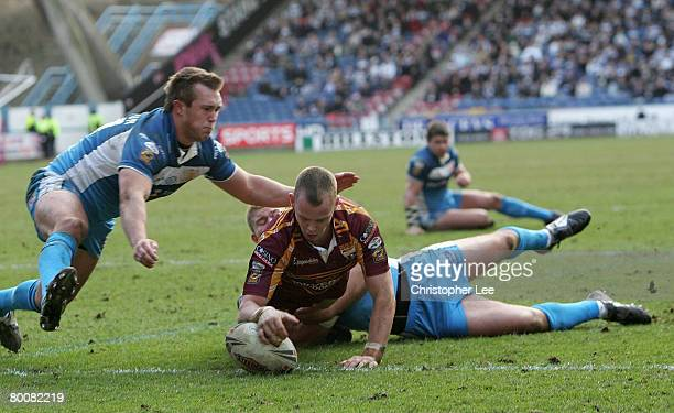 Kevin Brown of Huddersfield scores their second try during the Engage Super League match between Huddersfield Giants and Hull FC at the Galpharm...