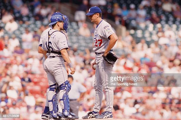 Kevin Brown of the Los Angeles Dodgers tals on the mound during a game against the Milwaukee Brewers at County Stadium on August 25 1999 in Milwaukee...