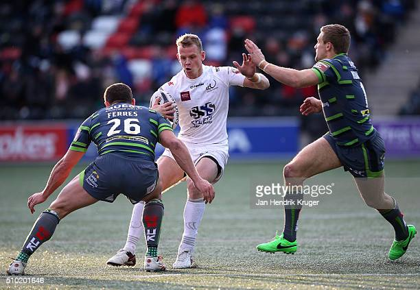 Kevin Brown of Widnes Vikings is tackled by Jimmy Keinhorst of Leeds Rhinos during the First Utility Super League match between Widnes Vikings and...