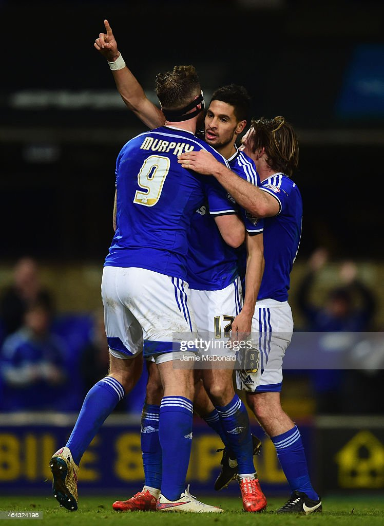 Kevin Bru of Ipswich Town (C) celebrates with Daryl Murphy (9) and Jay Tabb (18) as he scores their fourth goal during the Sky Bet Championship match between Ipswich Town and Birmingham City at Portman Road on February 24, 2015 in Ipswich, England.