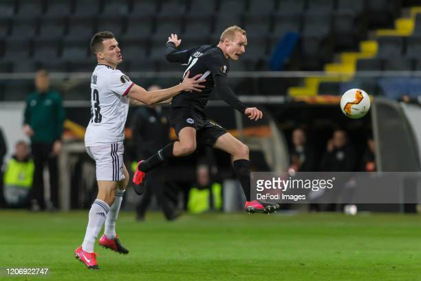 Kevin Bua of FC Basel 1893 and Sebastian Rode of Eintracht Frankfurt battle for the ball during the UEFA Europa League round of 16 first leg match...
