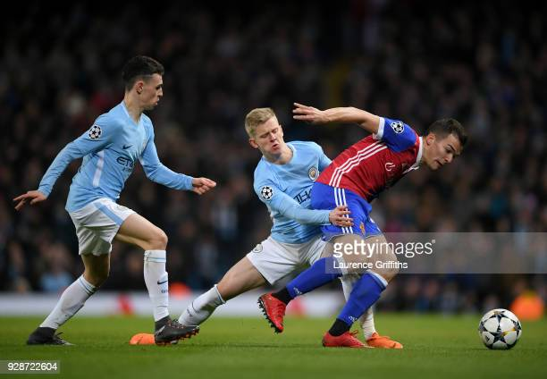 Kevin Bua of FC Basel holds off pressure from Alexander Zinchenko of Manchester City during the UEFA Champions League Round of 16 Second Leg match...