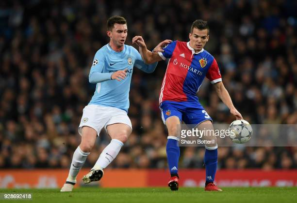 Kevin Bua of FC Basel holds off pressure from Aymeric Laporte of Manchester City during the UEFA Champions League Round of 16 Second Leg match...
