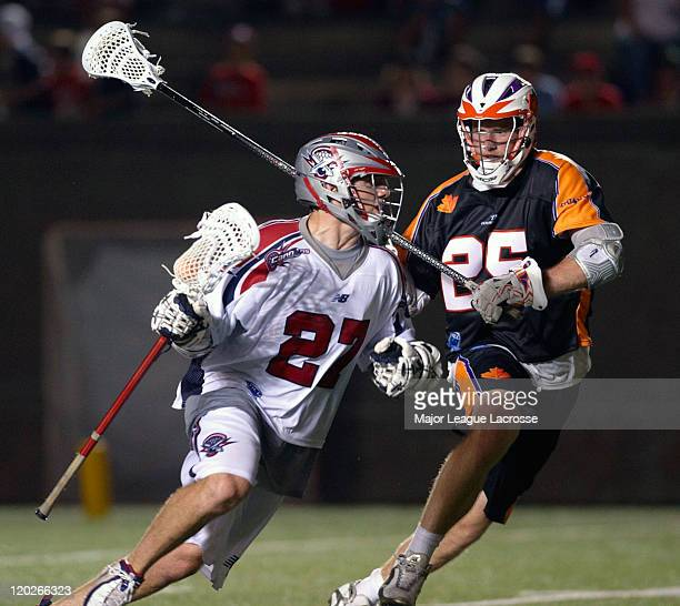 Kevin Buchanan of the Boston Cannons drives against defender Mike Timms of the Toronto Nationals on July 24 2010 at Harvard Stadium in Boston...