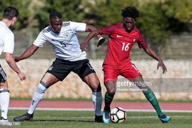 Kevin Bukusu of Germany U17 challenges Felix Correia of Portugal U17 during U17Juniors Algarve Cup match between U17 Portugal and U17 Germany at Bela...