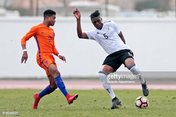 Kevin Bukusu of Germany U17 challenges Nigel Thomas of Netherlands U17 during U17Juniors Algarve Cup match between U17 Netherlands and U17 Germany at...