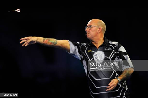 Kevin Burness of Northern Ireland in action against Paul Nicholson of England during Day Two of the 2019 William Hill World Darts Championship at...
