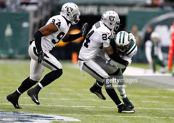 Kevin Burnett Charles Woodson of the Oakland Raiders coverage on Jeremy Kerley of the New York Jets during their game at MetLife Stadium on December...