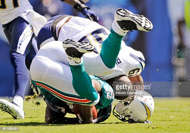 Kevin Burnett of the San Diego Chargers loses his helmet after a hit against Ronnie Brown of the Miami Dolphins during first quarter of the NFL...