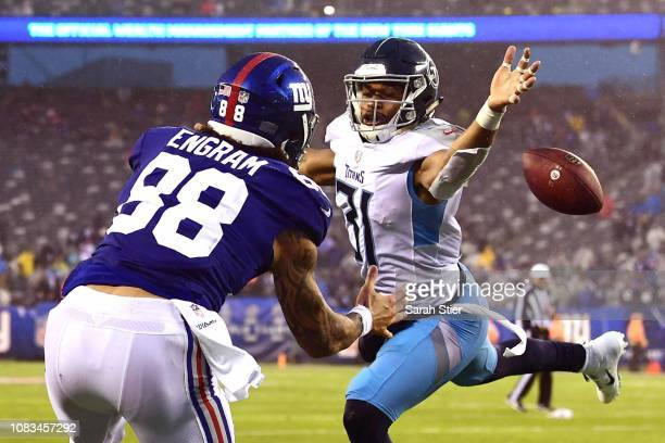 Kevin Byard of the Tennessee Titans breaks up a pass to Evan Engram of the New York Giants during the fourth quarter of the game against the New York...