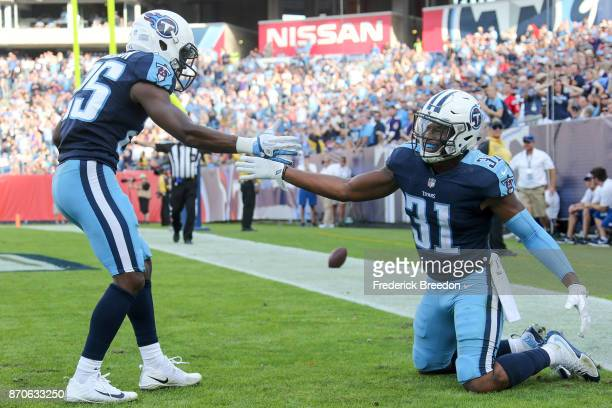 Kevin Byard of the Tennessee Titans celebrates with Adoree' Jackson after a stop in the endzone against the Baltimore Ravens during the second half...