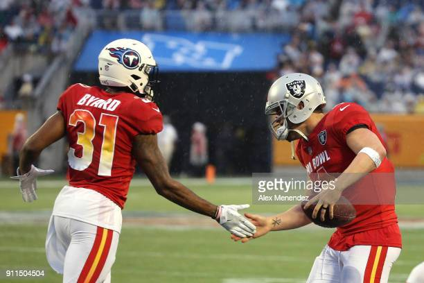 Kevin Byard of the Tennessee Titans celebrates with Derek Carr of the Oakland Raiders during the NFL Pro Bowl between the AFC and NFC at Camping...