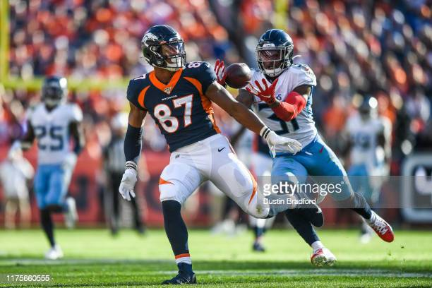 Kevin Byard of the Tennessee Titans intercepts a pass intended for Noah Fant of the Denver Broncos in the third quarter at Empower Field at Mile High...