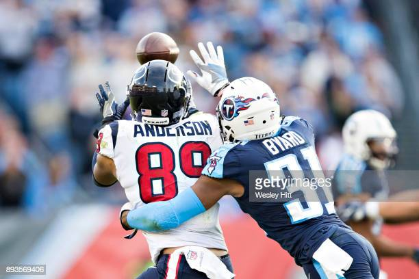 Kevin Byard of the Tennessee Titans knocks away a pass thrown to Stephen Anderson of the Houston Texans at Nissan Stadium on December 3 2017 in...