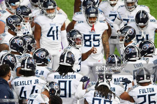 Kevin Byard of the Tennessee Titans speaks to his teammates during warmups before the game against the Minnesota Vikings at U.S. Bank Stadium on...