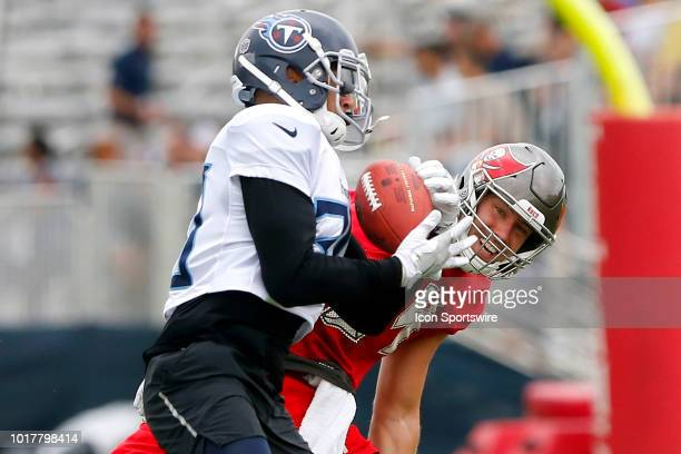 Kevin Byard of the Titans picks off the pass intended for Cameron Brate of the Bucs during the joint training camp work out between the Tampa Bay...