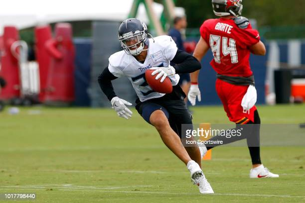 Kevin Byard of the Titans returns the interception during the joint training camp work out between the Tampa Bay Buccaneers and the Tennessee Titans...