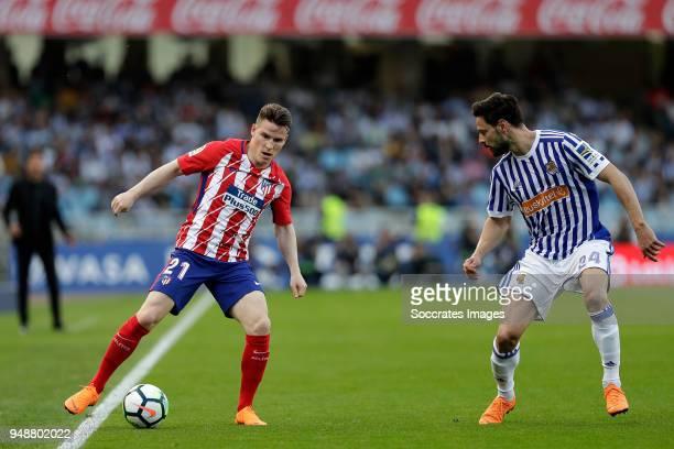Kevin Cameiro of Atletico Madrid Alberto de la Bella of Real Sociedad during the La Liga Santander match between Real Sociedad v Atletico Madrid at...