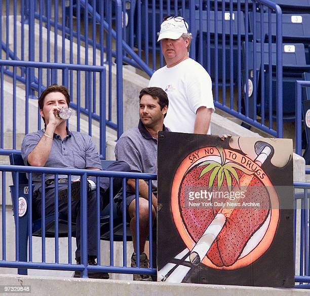 Kevin Campbell and Jim Varao of Tampa sit behind their antidrug poster complete with picture of a strawberry Reference is to Yanks' Darryl Strawberry...
