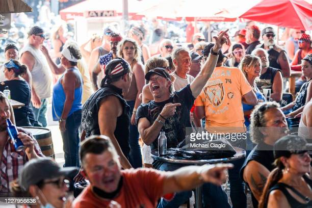 Kevin Campbell cheers while watching a band perform during the 80th Annual Sturgis Motorcycle Rally on August 7 2020 in Sturgis South Dakota While...