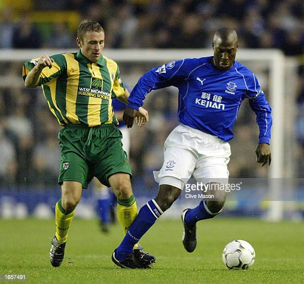 Kevin Campbell of Everton is challenged by Ronnie Wallwork of West Bromwich Albion during the Barclaycard Premiership match between Everton and West...