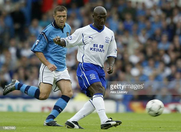 Kevin Campbell of Everton shoots at goal during the Barclaycard FA Premier League match between Manchester City and Everton at Maine Road Manchester...