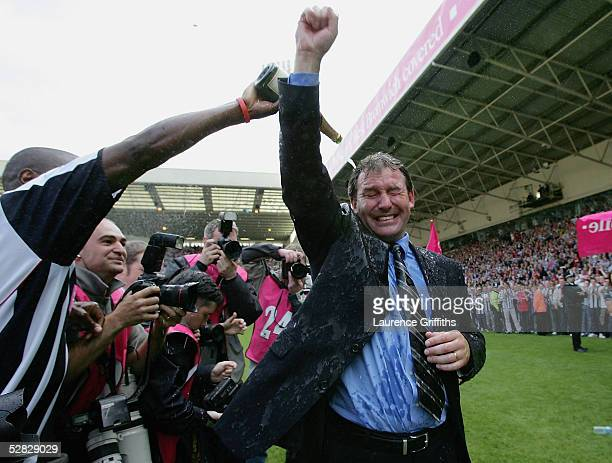 Kevin Campbell pours champagne over Bryan Robson of West Brom after securing premiership status at the end of the Barclays Premiership match between...