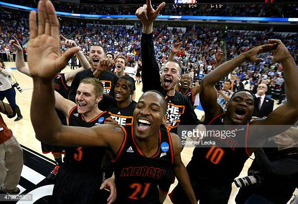 Kevin Canevari, Langston Hall and Ike Nwamu of the Mercer Bears celebrate the Bears 78-71 victory against the Duke Blue Devils in the second round of...