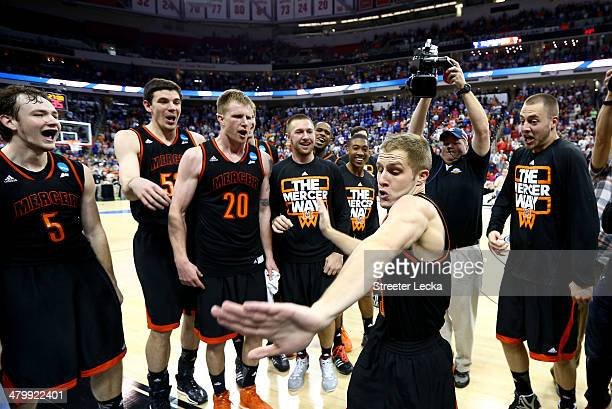 Kevin Canevari of the Mercer Bears celebrates with teammates after defeating the Duke Blue Devils 7871 during the Second Round of the 2014 NCAA...