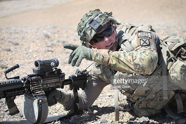 Kevin Carrin from Frederick Maryland with the US Army's 2nd Battalion 87th Infantry Regiment 3rd Brigade Combat Team 10th Mountain Division keeps...