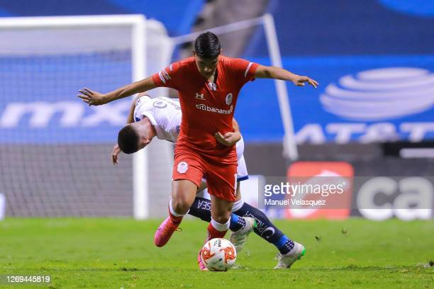 Kevin Castañeda of Toluca struggles for the ball against Santiago Ormeño of Puebla during the 7th round match between Puebla and Toluca as part of...
