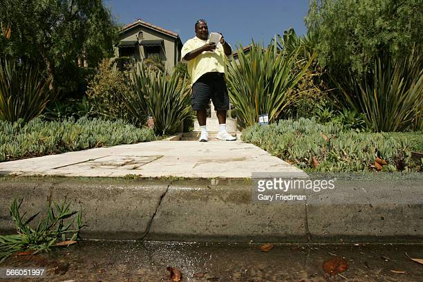 Kevin Cato writes a water violation on Lucerne in the Hancock Park area of Los Angeles on August 7 2009 Cato is a commercial field representative for...
