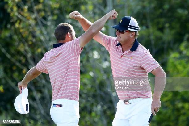Kevin Chappell and Charlie Hoffman of the US Team celebrate on the 13th green after defeating Anirban Lahiri of India and the International Team and...