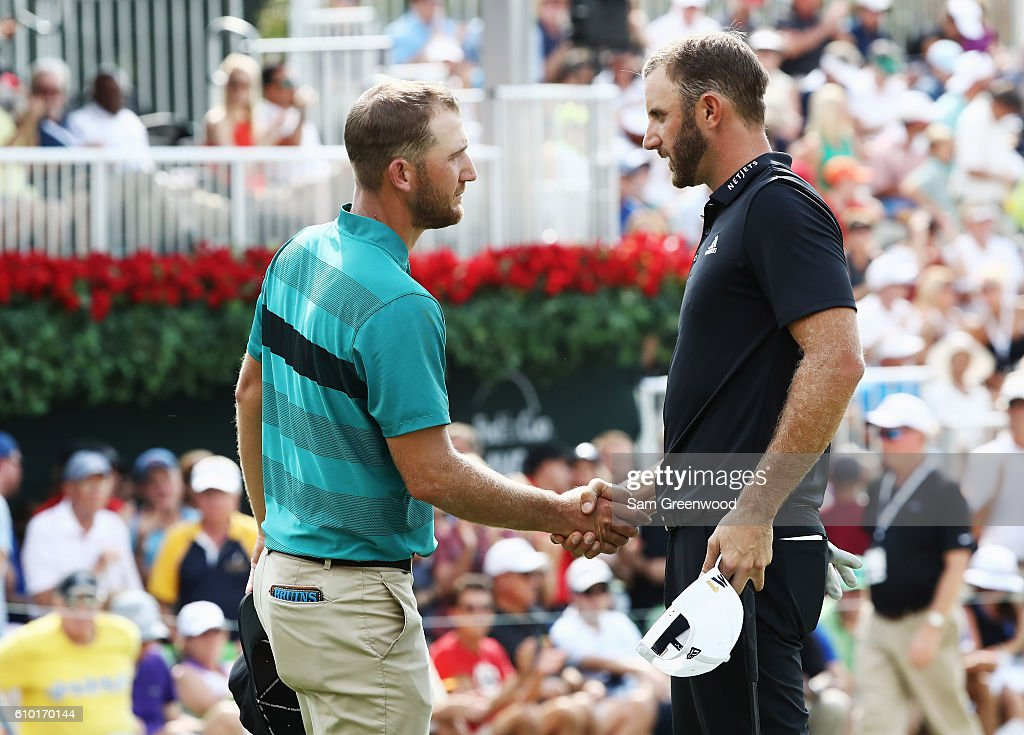 Kevin Chappell (L) and Dustin Johnson shake hands on the 18th green during the third round of the TOUR Championship at East Lake Golf Club on September 24, 2016 in Atlanta, Georgia.