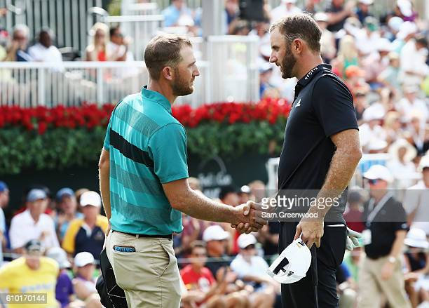 Kevin Chappell and Dustin Johnson shake hands on the 18th green during the third round of the TOUR Championship at East Lake Golf Club on September...