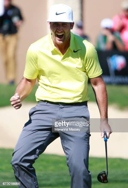 Kevin Chappell celebrates after putting in to win on the 18th green during the final round of the Valero Texas Open at TPC San Antonio ATT Oaks...