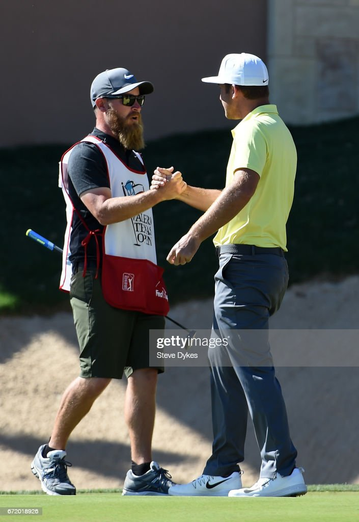 Kevin Chappell celebrates with his caddie Joe Greiner after putting in to win on the 18th green during the final round of the Valero Texas Open at TPC San Antonio AT&T Oaks Course on April 23, 2017 in San Antonio, Texas.